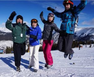 PHOTO: a few group members happy to be on the slopes after a long trip